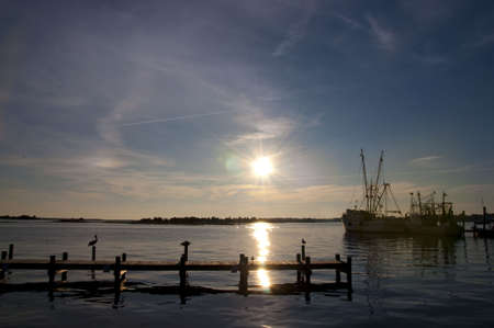 shrimp boat: Pelicans and Shrimp Boats at Dusk in Swansboro, North Carolina Stock Photo
