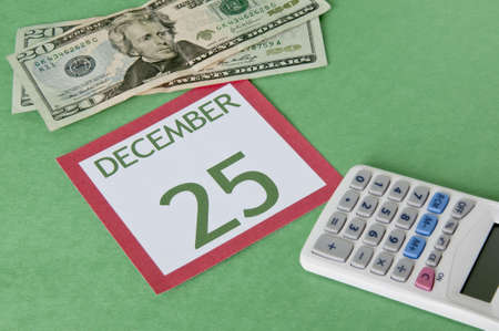 Calendar page with currency and a calcular for a tight budget this Holiday season.  Be careful not to overspend!
