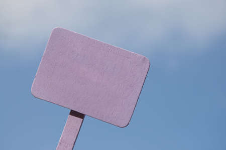 Bright purple sign on a blue sky background.  Blank for your message.  Climate Change, Global Warming, Nature, Outdoors, Gardening, Etc. Stock Photo