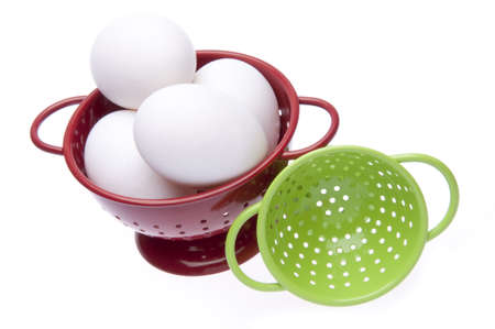 protien: Red colander filled with fresh eggs, and green colander on the side.  Image for the kitchen or a modern take on Easter.