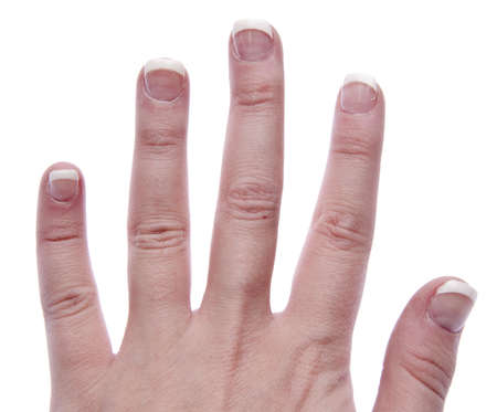 Hand with short nails done in a french manicure. Banco de Imagens