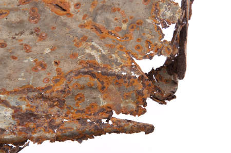 This rusty metal background was created from an old cieling tile and features a circular pattern. Stock Photo