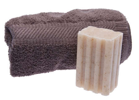 Put out a fresh towel and bar of soap for your houseguests.  Image is isolated on white