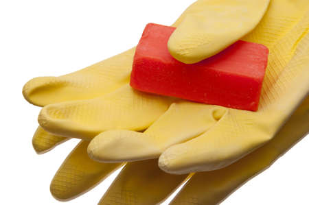 Yellow cleaning gloves with soap ready to tackle any job! Isolated on white  Фото со стока