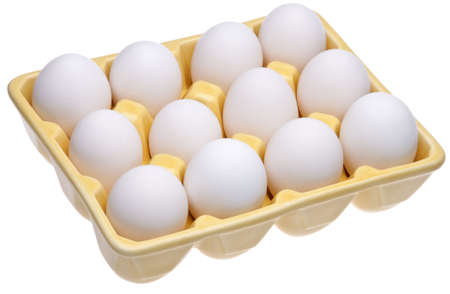 Dozen eggs in a fun open yellow cartion.  Great food, spring or Easter image.  Isolated on white with a clipping path. photo