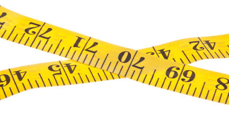 healthy path: Yellow measuring tape for diet, healthy and sewing themed use.  Isolated on white with a clipping path. Stock Photo