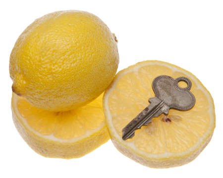 but think: Key with lemon symbolizes a car or house that is a lemon - something you think is good, but turns out to be broken.  Isolated on white with clipping path.