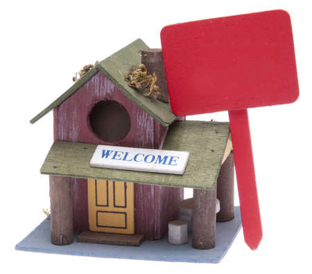 sold small: This house with a red sign can be used as a bird house or conceptual house image.  The sign is blank for your message.  SOLD!  Foreclosure! For Sale!  Etc. Isolated on white with a clipping path.