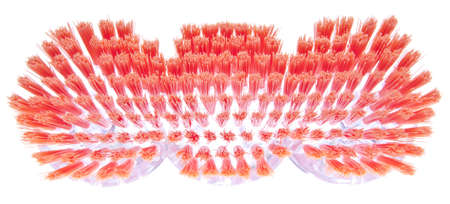 Vibrant Bristles of a Spring Cleaning Brush. Isolated on white with a clipping path. Imagens