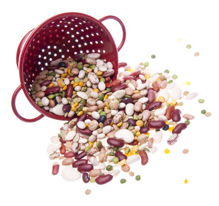 Brightly Colored Beans in a Colander Isolated on White. Zdjęcie Seryjne