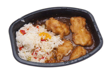 Chicken and Rice with Sauce TV Dinner Isolated on White.