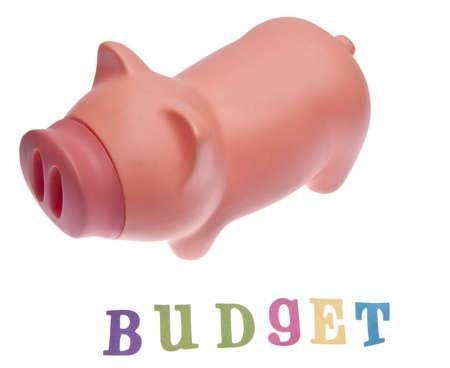 A piggy bank and the word budget Banco de Imagens