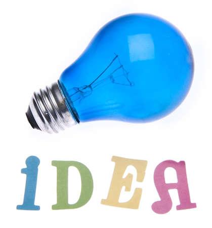 Blue light bulb and the word idea