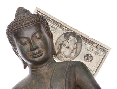 Buddha with money to represent the money the religion makes.