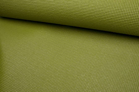 Green Yoga  Exercise Mat, Partially Rolled. photo