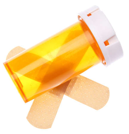 Prescription bottle with band aids for health care and medicine themes photo