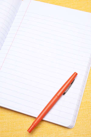 pin board: Open notebook with colorful pen for the modern student or office. Stock Photo