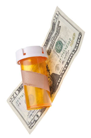doctor money: A prescription bottle with a plaster and currency represents the cost of health care.