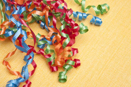 Party streamers on a yellow background. Stock Photo - 6687356