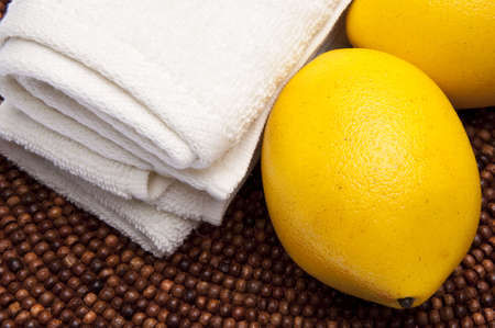 Fresh lemons are at the center of this spa related image. Stock Photo