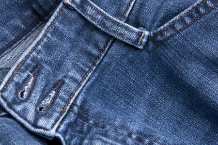 Close up of denim blue jeans background image. photo