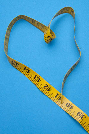 Heart Shaped Measuring Tape on a Vibrant Background. Stockfoto