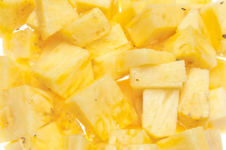 Fresh sliced yellow pineapple background image on white. Zdjęcie Seryjne