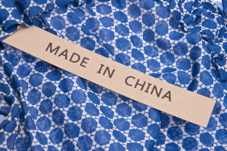Bright blue shirt with Made in China tag. photo