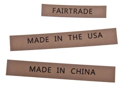 Labels state Fair Trade, Made in the USA and Made in China.  Isolated on White.