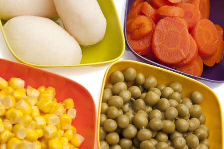 Vibrant Canned Vegetables Isolated on White close up.  Carrots, Corn, White Potatoes, and Peas. Stock Photo - 6762333