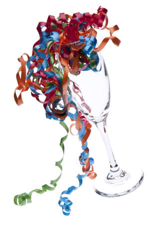 Champagne glas met partij Streamers.  New Years Eve of partij beeld. Stockfoto