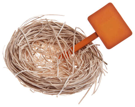 Empty Nest with a Sign for Family and Real Estate Concepts. 版權商用圖片