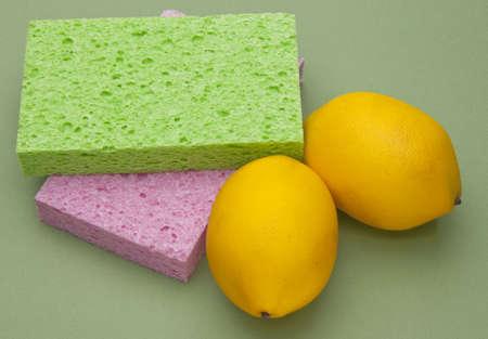 Sponges and Lemons on a Sage Colored Background. Stok Fotoğraf