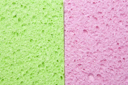 Green and Pink Sponges Showing Texture. photo