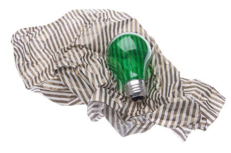 Green Lightbulb with Giftwrap Represents Ideas for Green Gift Giving.