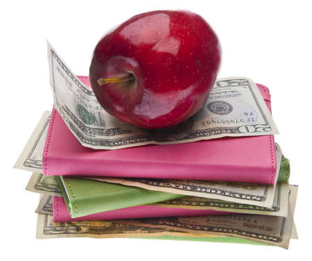 Apples, Books and Money for Health Care and Education Themed Images. photo