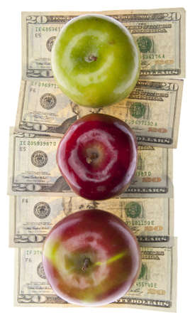 Apples and Money for the Rising Cost of Health Care and Education.  Isolated on White. Stock Photo - 6881660