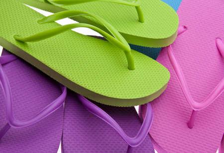 Vibrant colored summer flip flops background image. Stock Photo - 6881822
