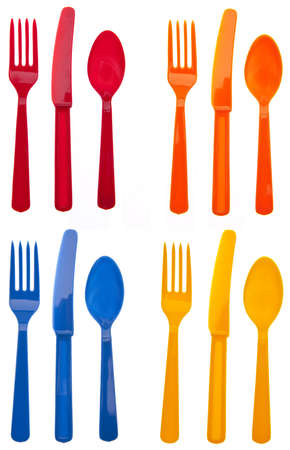 Four Sets of Vibrant Plastic Forks, Knives and Spoons in Red, Orange, Yellow and Blue.
