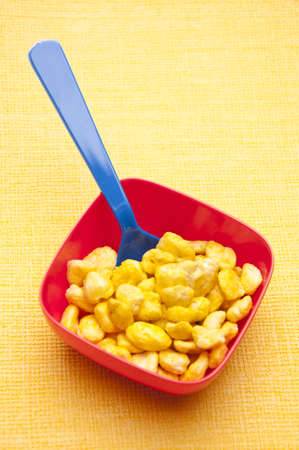 Cereal in a Vibrant Bowl on a Yellow Background. photo