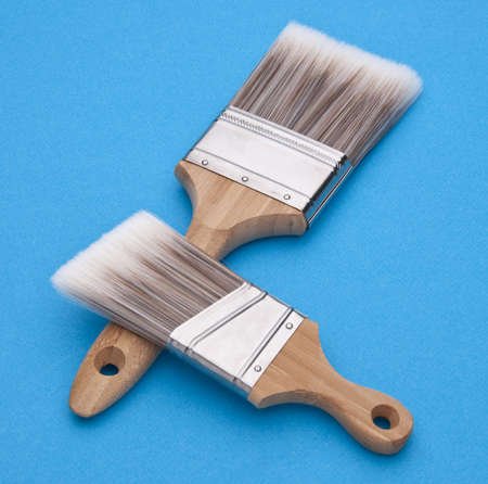 Home Improvement Scene.  Pair of Paintbrushes on Blue. Stock Photo - 6882625