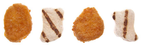 breading: Chicken Nugget Choice of Breaded and Friend Nuggets vs. Baked Organic Nuggest.  Health and Food concept