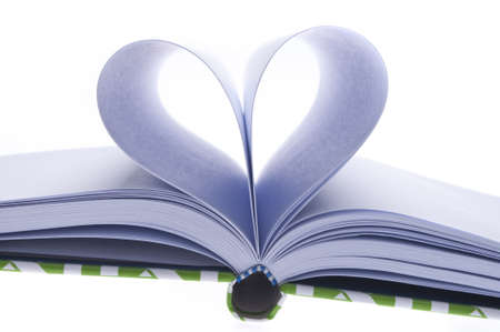 Blank Journal with Pages Folded in a Heart Shape in Shadow on a White Background. photo