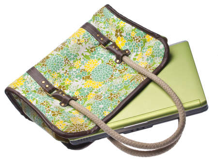 Floral Purse with Green Laptop Computer.  Work on the Go Concept. photo