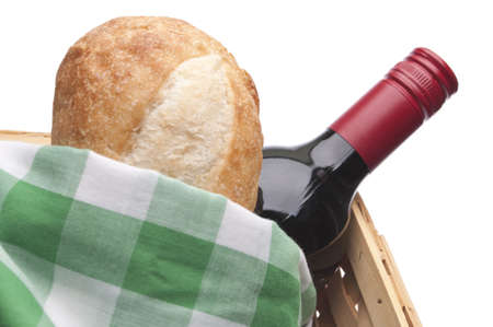 Summer Picnic Scene with Bread, Red Wine and a Picnic Basket.  Isolated on White  photo