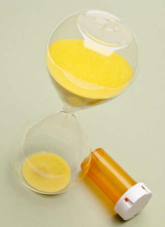 Hourglass and Prescription Bottle Symbolize Time Until Death.