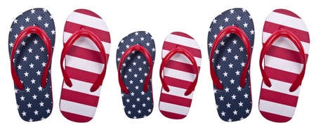 Flip Flop Sandals in American Red White and Blue in Two Large Sizes, and One Small Size Symbolize a Family. Isolated on White  Stock Photo - 6981277