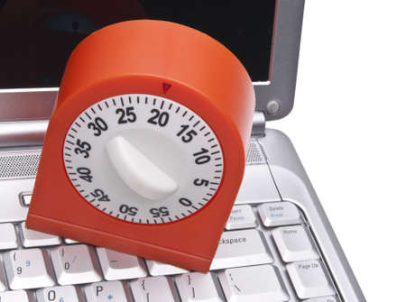 Time on the Internet Concept with Keyboard and Kitchen Timer.  Monitoring How Much Time You Spend Online.