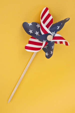 Pinwheel with USA Flag Pattern on a Vibrant Yellow Background. Stock Photo - 7065368