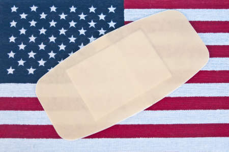 American Flag with Bandage for Concept of America Wounded. Stock Photo - 7065373